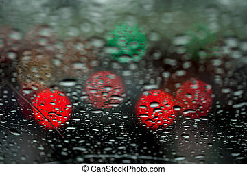 View of the night city through the window on a rainy night,...