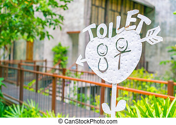 Sign hung over the entrance to a toilet . - Sign hung over...