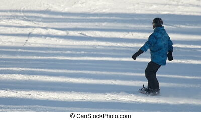 Snowboarding in the winter park - Snowboarder down the hill,...