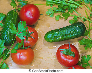 Healthy fresh wet vegetables on the wooden table