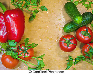 Fresh healthy vegetables on wet wooden table