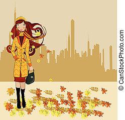 Girl walking on autumn street