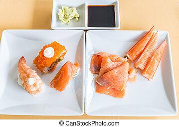 Sushi an sashimi in white dish