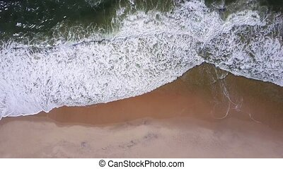 Ocean waves crashing on beach