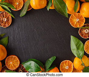 christmas card with fruit frame of tangerines