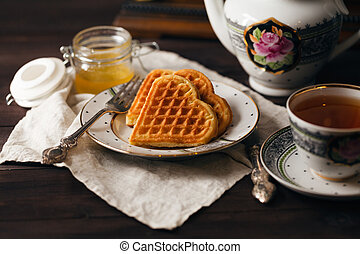 Breakfast wih wafers and tea cup