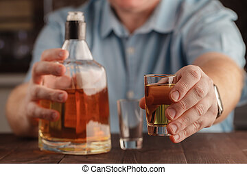 man offering some shot of alcohol as a solution to your...