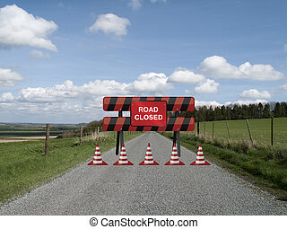 Road closed sign on barrier due to resurfacing work on...