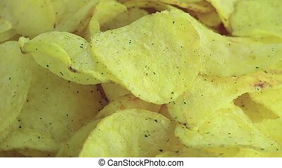 Golden potato chips sprinkled on the plate