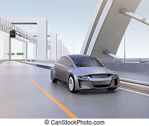 Silver autonomous car driving on the highway with monorail...