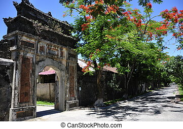 Hue Citadel Gate - Beautiful gate close to a tree with red...