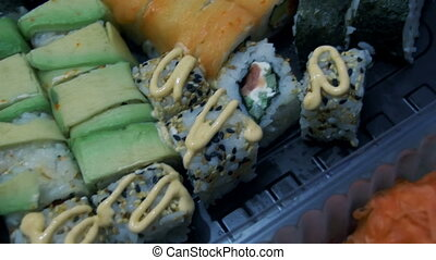 Sushi in Plastic Box - Sushi in plastic box full of...