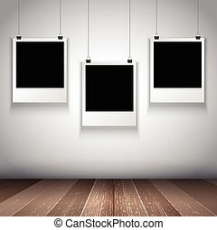 collection of hanging blank photos