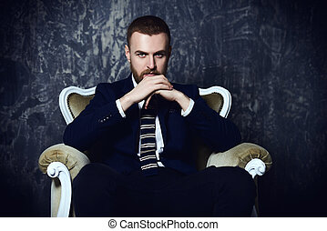 serious mature man - Respectable handsome man sitting in...