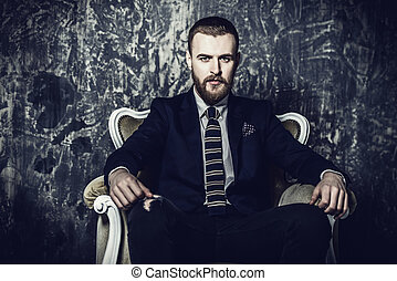 strong financial position - Respectable handsome man sitting...