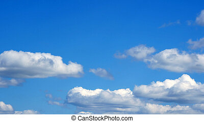 white fluffy clouds over blue sky on sunny day - Timelapse...