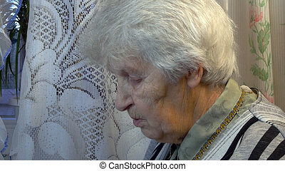 Portrait of the old talking woman close up