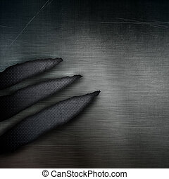 Dark grunge perforated metal background with torn parts