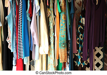 Thrift store. - Thrift store with used clothes hanging out...