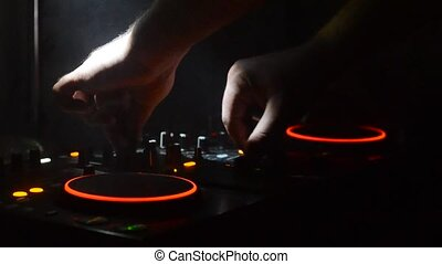 DJ Spinning, Mixing, and Scratching in a Night Club, Hands...
