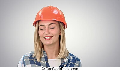 Construction worker talking to camera on white background. -...