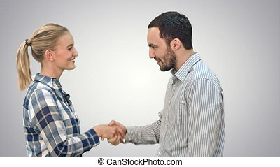 People meet and shake hands on white background. - People...