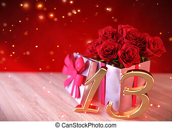 birthday concept with red roses in gift on wooden desk. thirteenth. 13th. 3D render