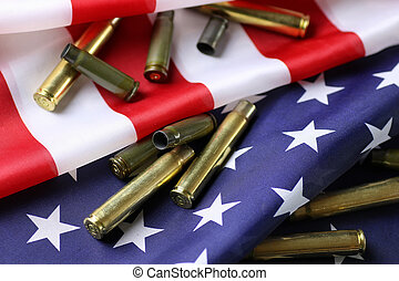 bullet on the USA flag - many shell casings from bullets of...