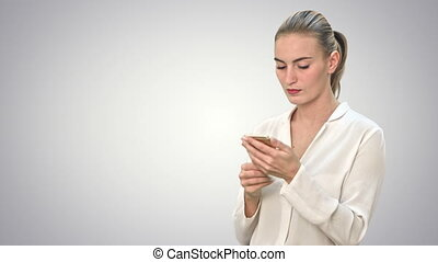 Pensive business woman using mobile cell phone reading...