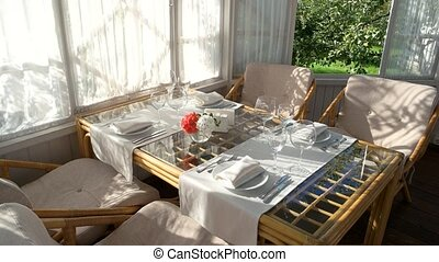 Dining table near window. Empty plates and glasses. Cheap...