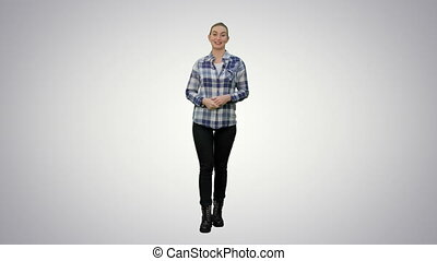 Happy smiling woman in casual presenting and showing something on white background.