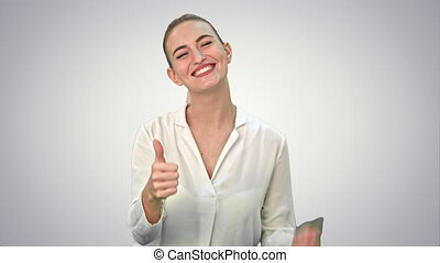 Happy excited woman showing approval hand gesture thumb up...