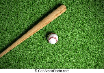 baseball and wodden bat on grass