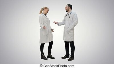 Young medical students give each other five after exam on white background.