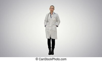 Smiling beautiful woman in lab coat talking to the camera on white background.