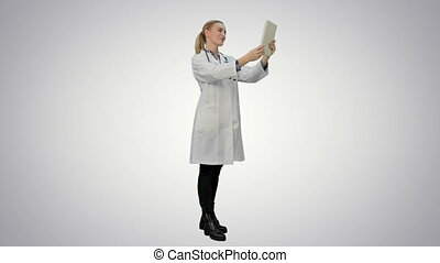 Doctor greeting medical partenrs and have a conversation online via tablet on white background.