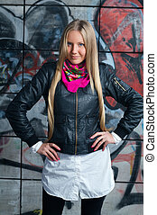 blonde woman posing in front grafitti - beauty young blonde...