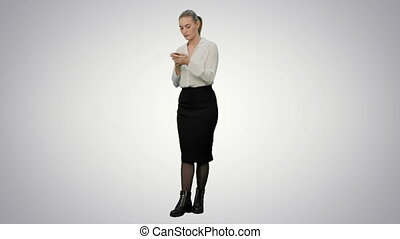 Annoyed young woman having bad news from her angry boss by the phone on white background.
