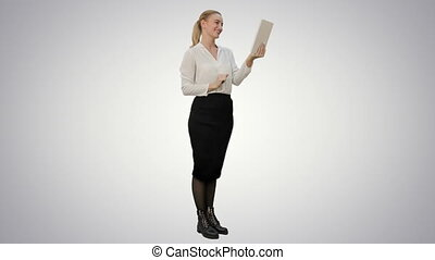 Young businesswoman have a video chat on tablet computer on white background.