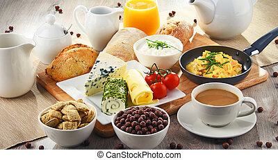 Breakfast served with coffee, cheese, cereals and scrambled...