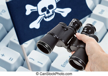 Binoculars and Pirate Flag, concept of Computer Hacker