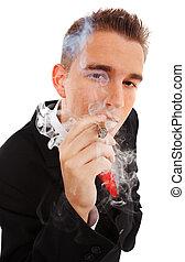 Young man in smoke cloud