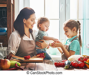 Happy family in the kitchen. - Healthy food at home. Happy...