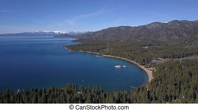 Aerial view of Lake Tahoe with paddle wheel boat moored in a...