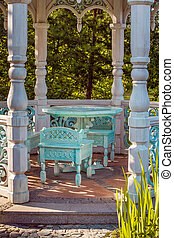 Chairs and table inside alcove at countryside