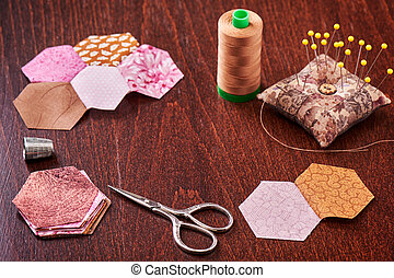 Sewing of hexagon pieces of fabric a quilt Grandmother's Flower Garden