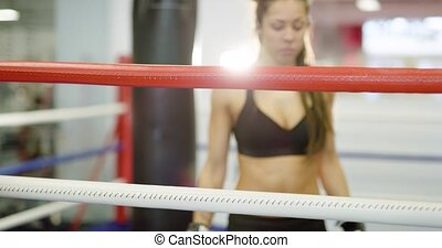 Beautiful woman tired after workout in boxing ring -...