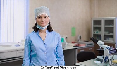 Hospital laboratory with equipment and microscope. Portrait...