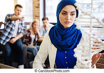 Smart muslim woman studying DNA model - Do not pay...
