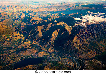 Aerial landscape view of mountain range, river and lake, NZ